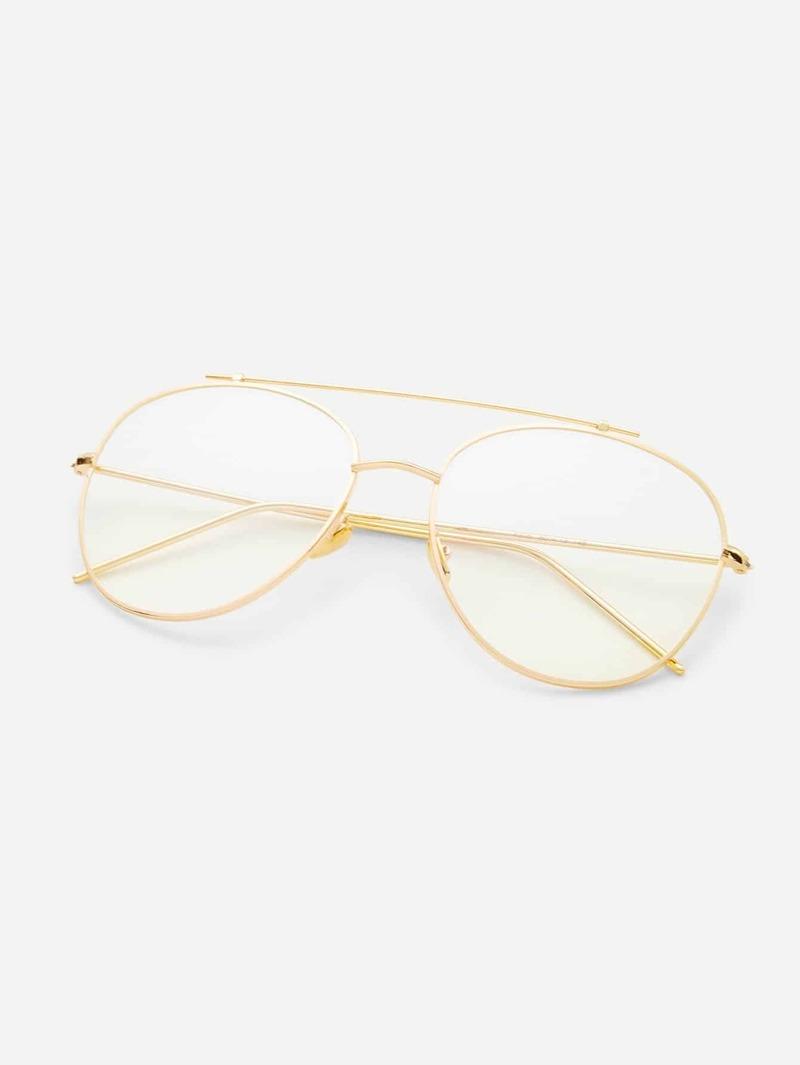 mejor sitio web e021f 698a7 Gafas de sol doble puente con marco dorado y lentes transparente