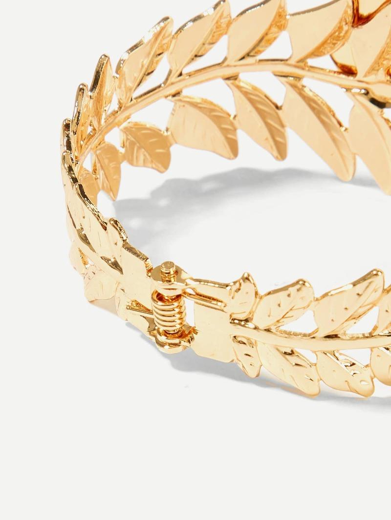 venta caliente online 0ef40 bd6a3 Brazalete dorado con diseño de hojas