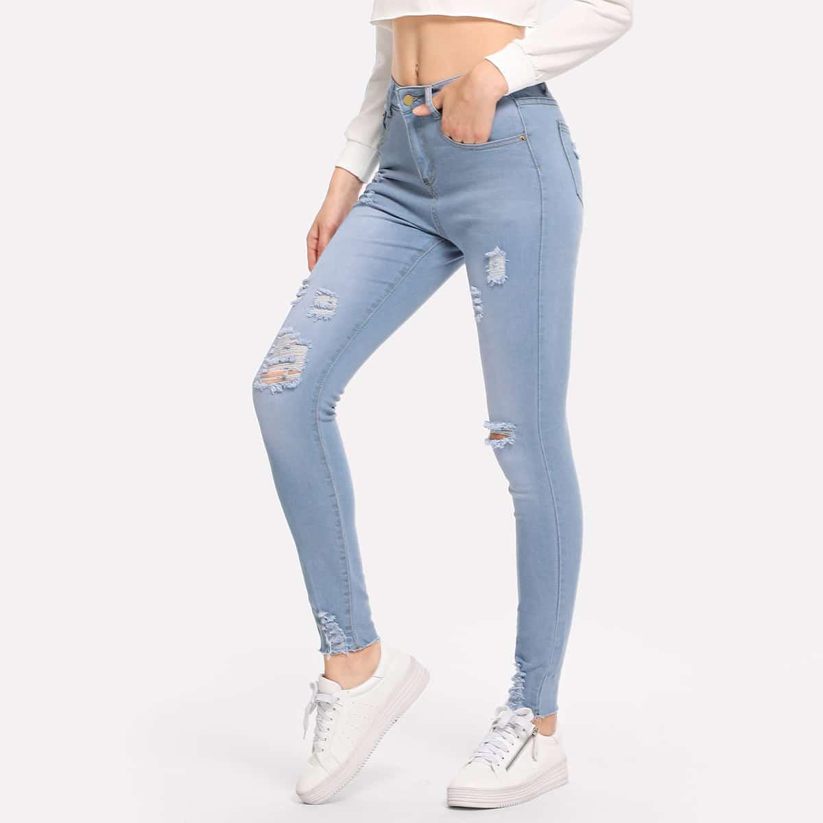 Рваные облегающие джинсы с небработанным краем