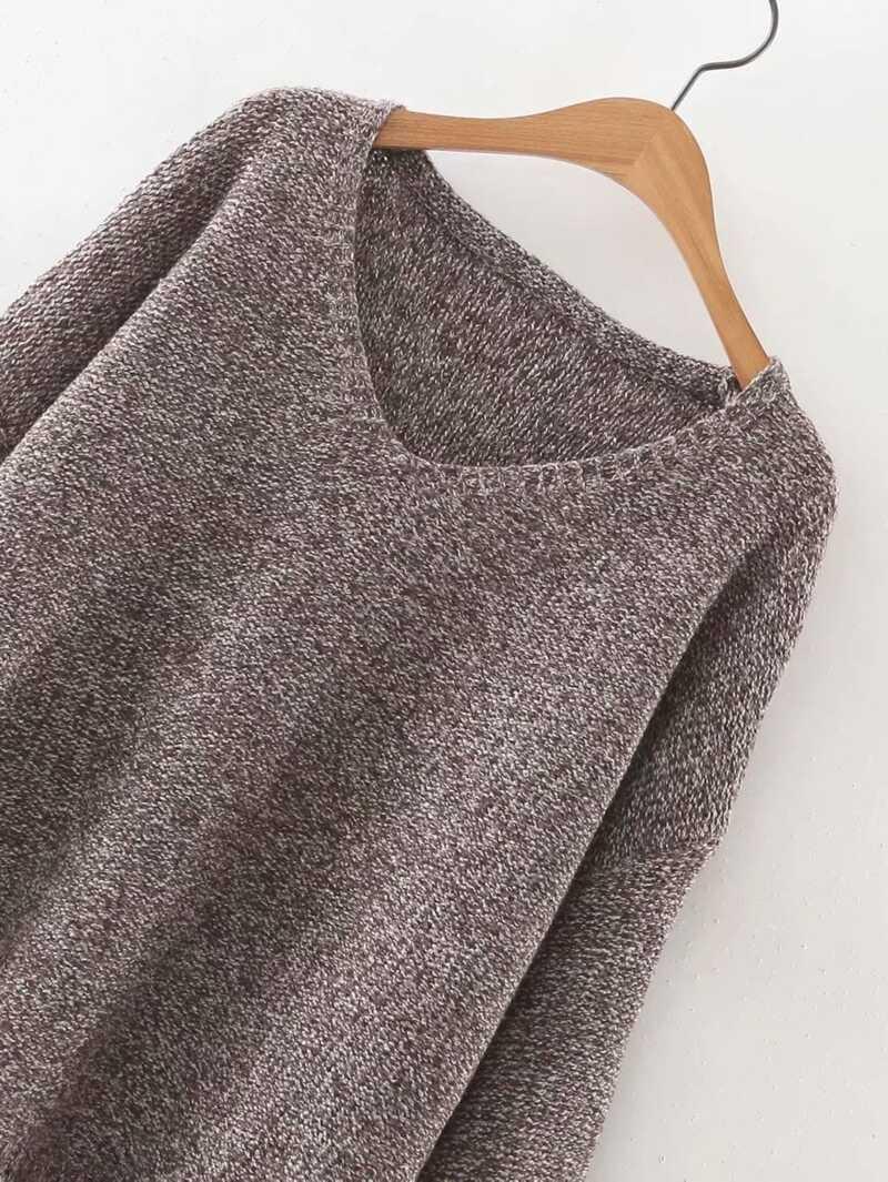 Pull en tricot à bord asymétrique frangé