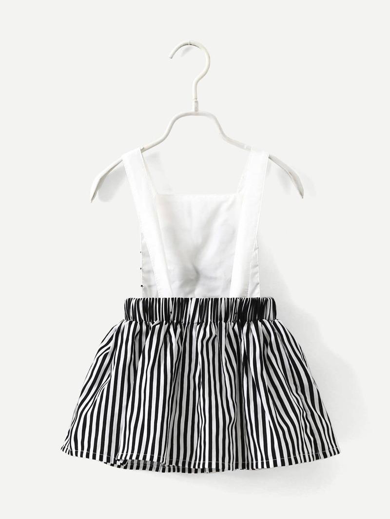 cb59ead83 Vestido de tirantes con dibujo y falda de rayas
