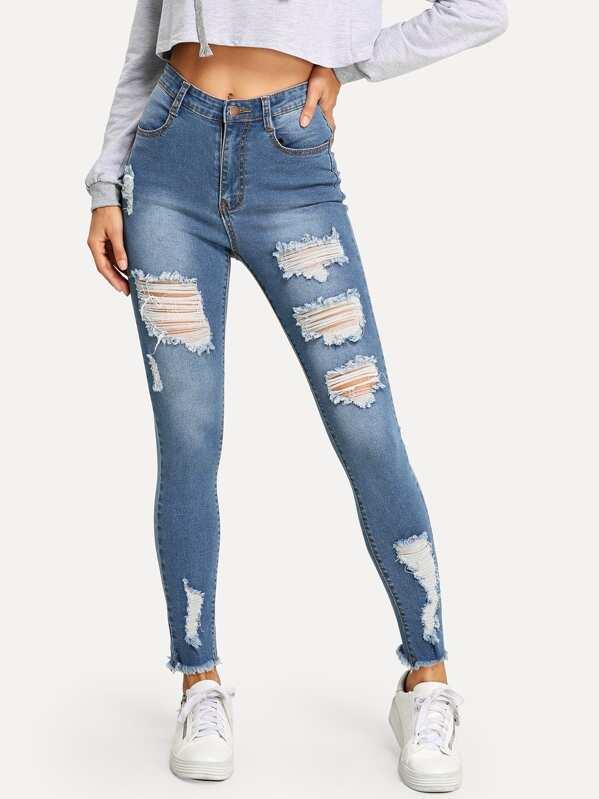 f05bcd58a08d6 Verblasste Jeans mit Rissen