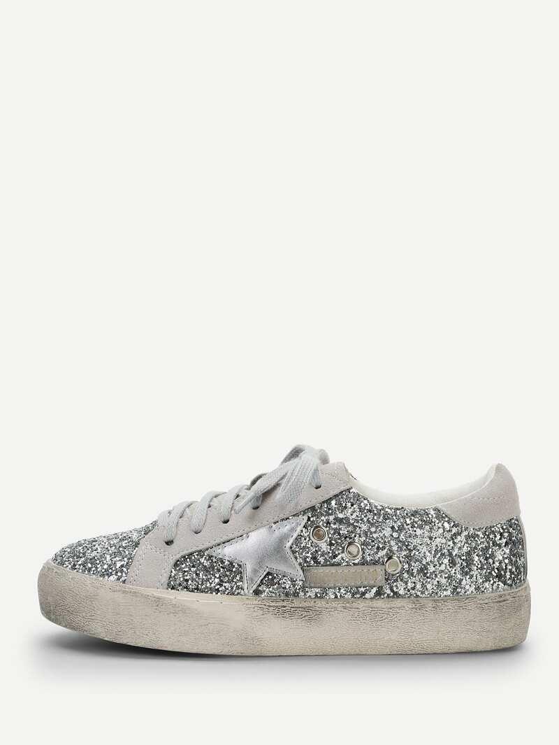 Zapatillas de deporte con brillos y detalle de estrella