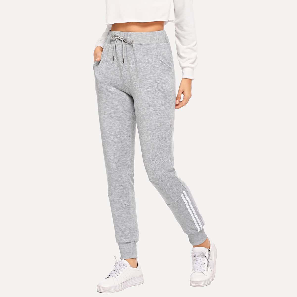 Контрастные брюки в полоску с эластичной талией