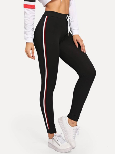 Leggings con bandas laterales