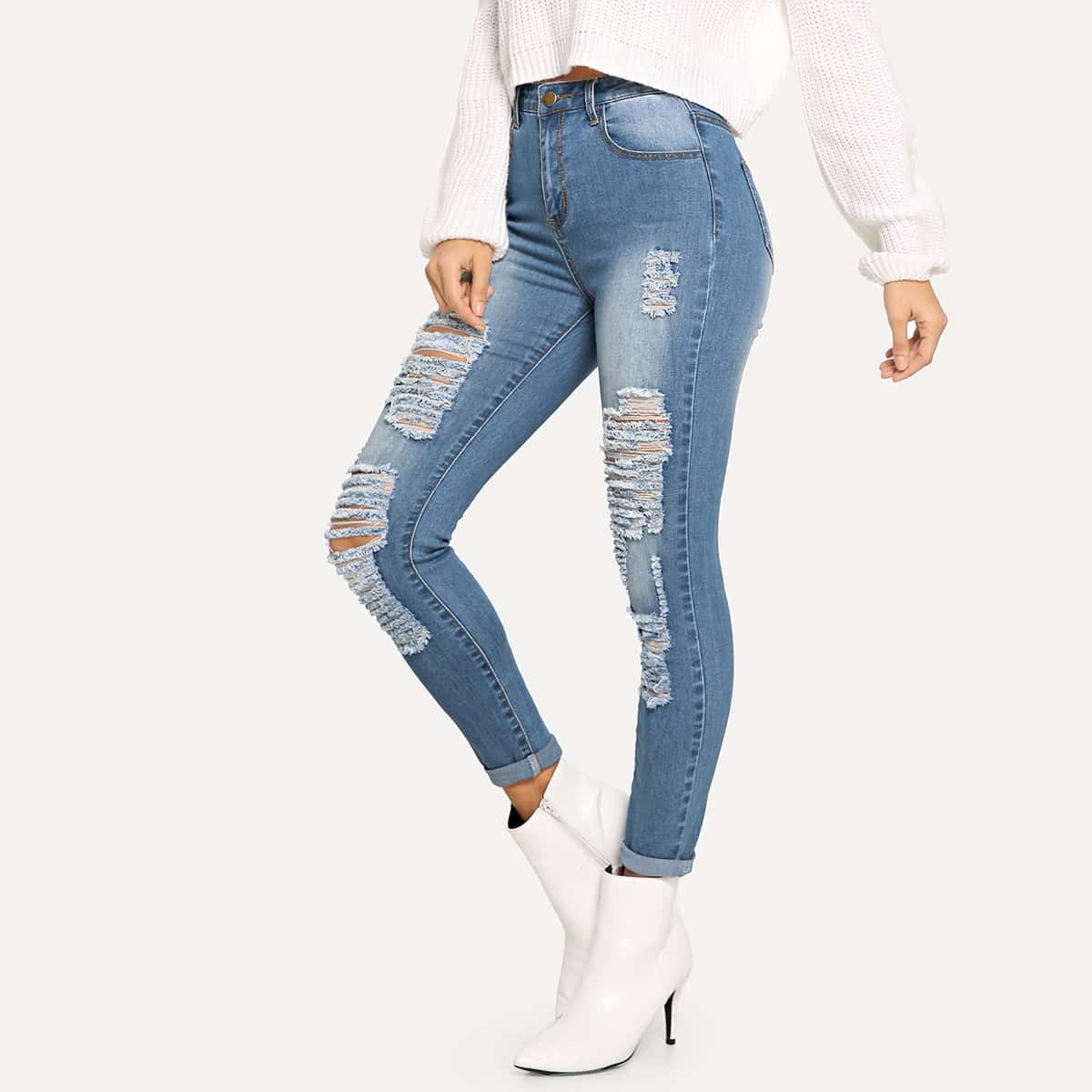 Рваные джинсы с разрезами