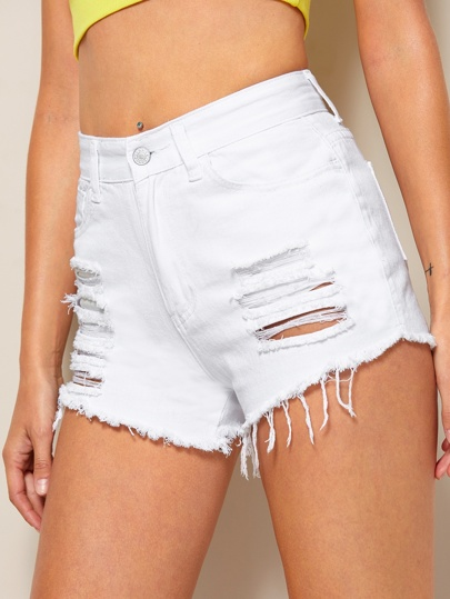 Shorts in denim strappato con orlo grezzo