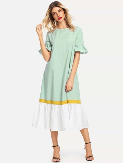a505632e4c98a فستان بحافة دلفين وبألوان متجانسة