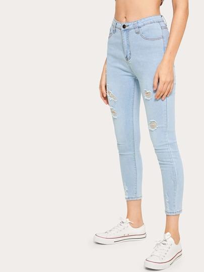 851c0bdd13e1 Jeans strappati con tasca e bottone