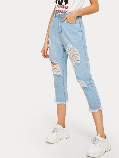 ff2573188dc2 Jeans con strappati e orlo grezzo