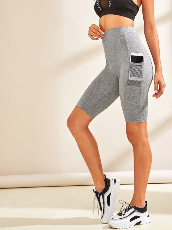 5e6272be012e Shorts ciclistas con bolsillo con malla