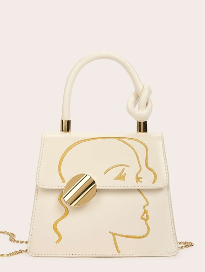 4726d6f6c Bolsa cartera con bordado de cara con diseño de nudo