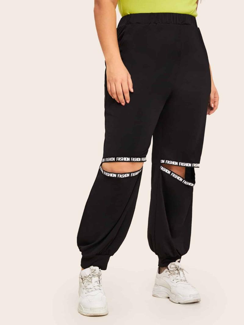 c4c7bf335f14 Pantalones con abertura con cinta con estampado de letra - grande