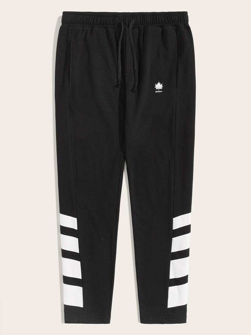 2bce487d Pantalones deportivos de hombres con bolsillo oblicuo de cintura con cordón  con estampado mixto