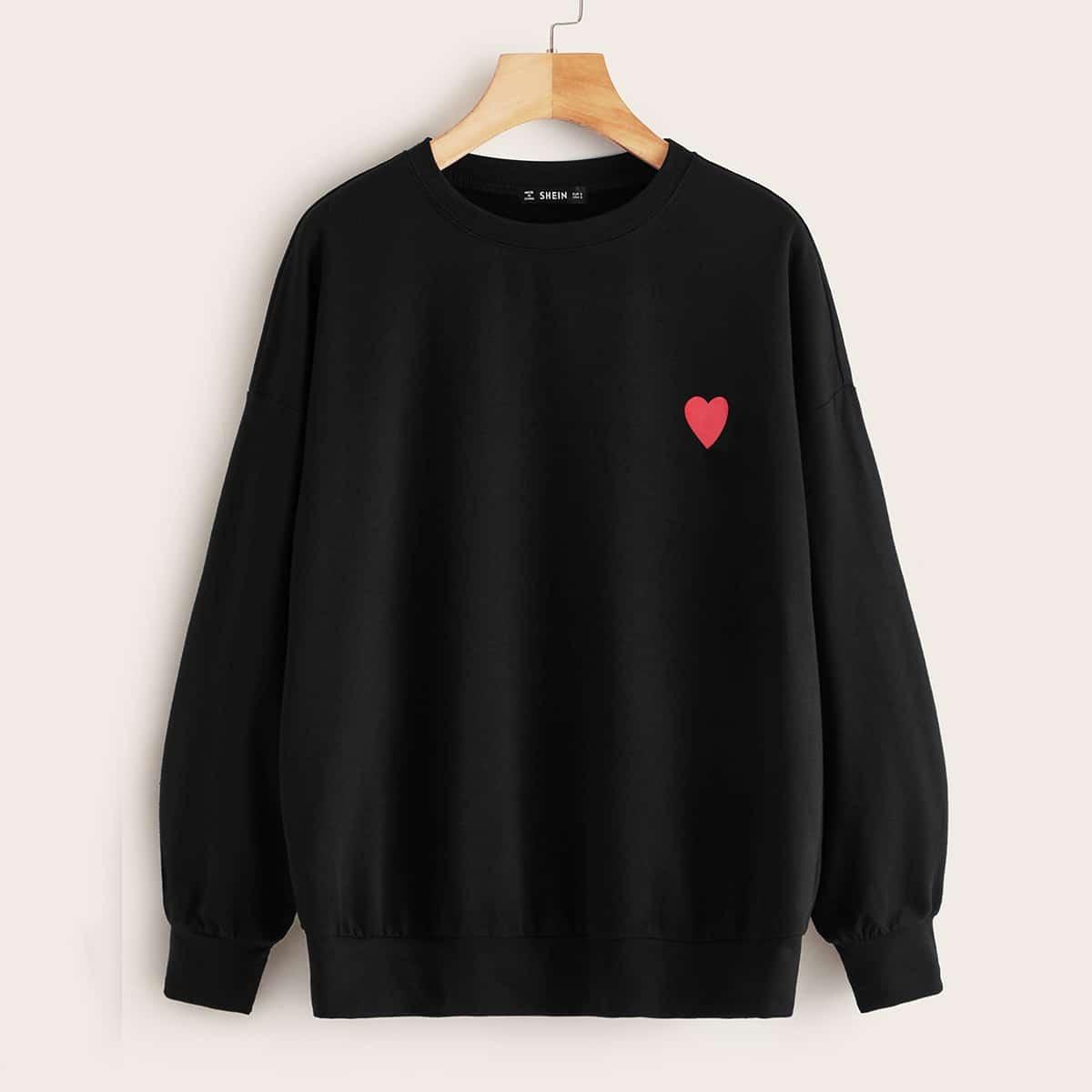 Однотонный пуловер с вышивкой на груди