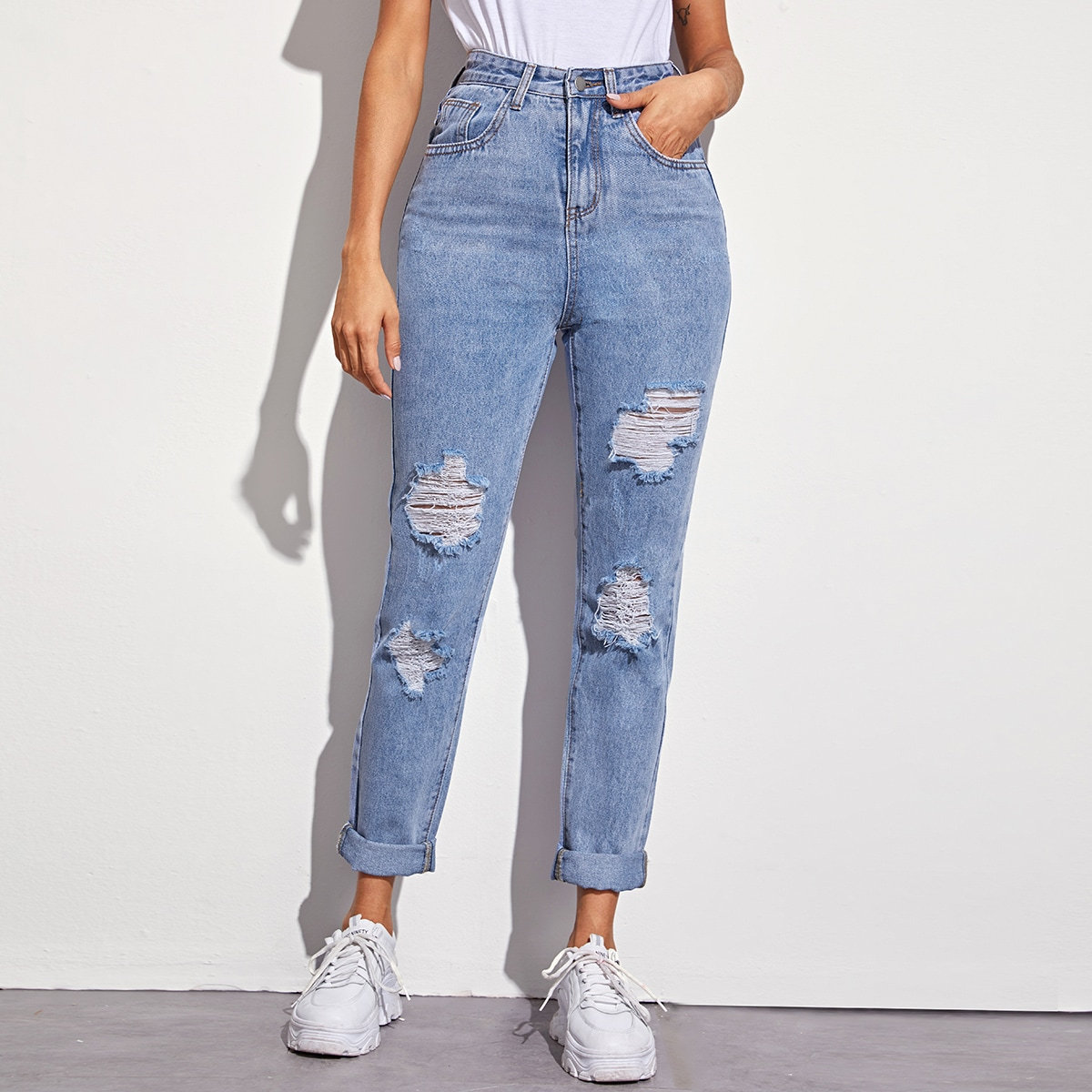Однотонные рваные джинсы с 5 карманами