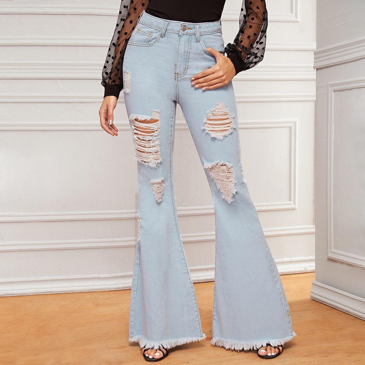 Рваные расклешенные джинсы с необработанным низом