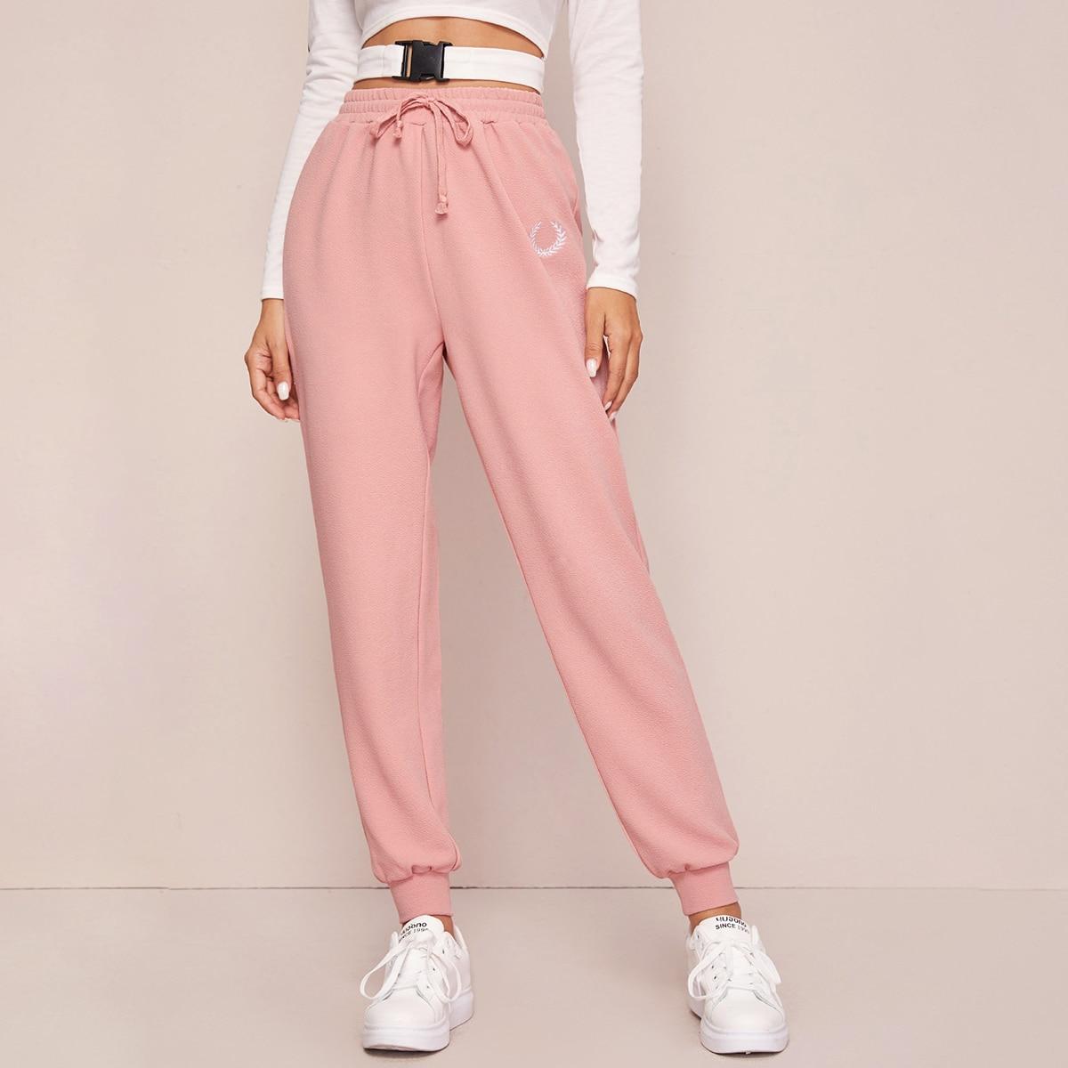 Спортивные брюки с вышивкой на куличке