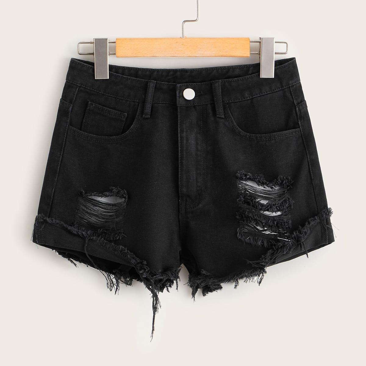 Рваные джинсовые шорты