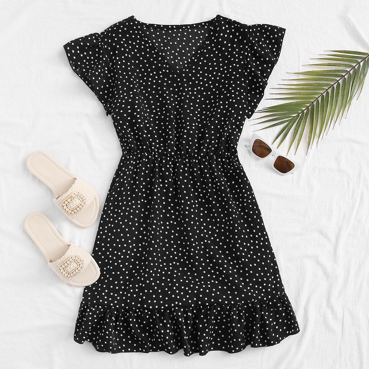 Расклешенное платье в горошек с v-образным вырезом