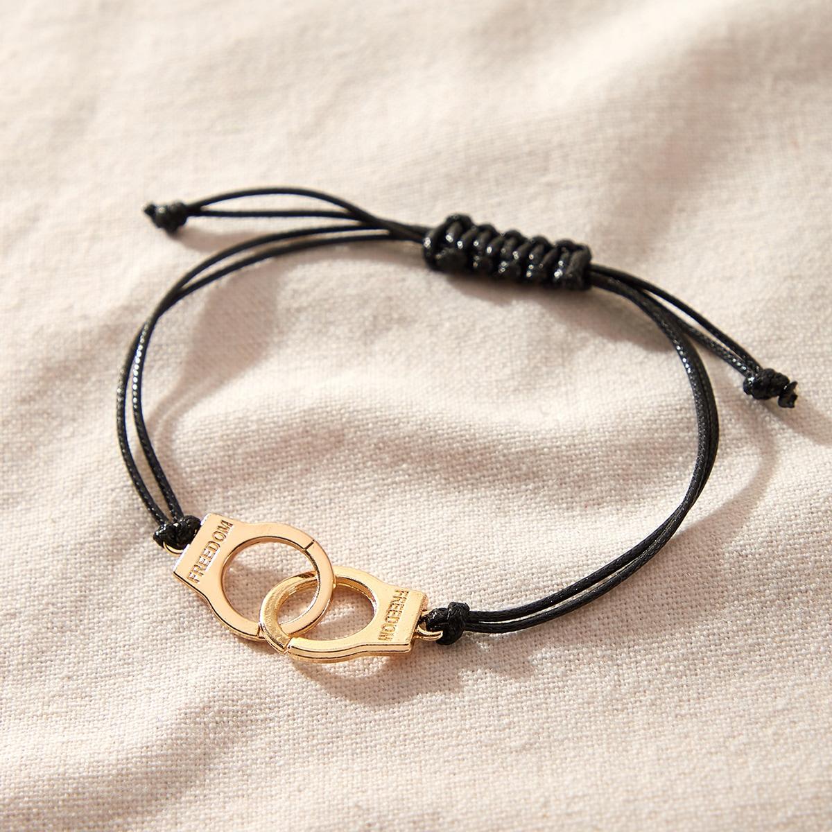 Плетеный браслет в форме наручников