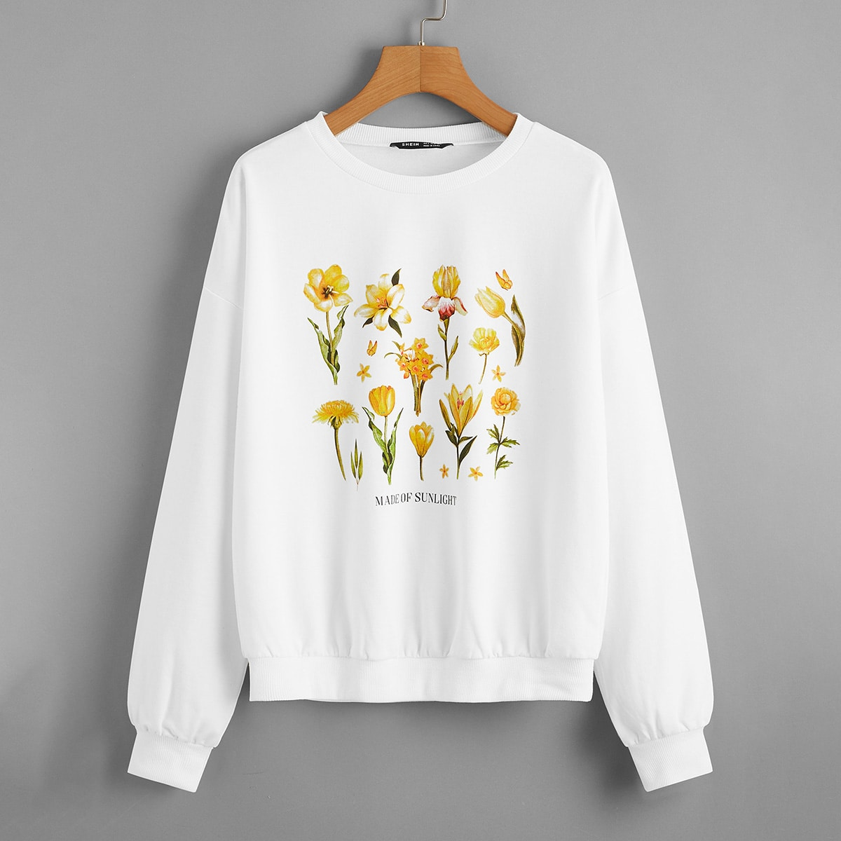 Пуловер с текстовым и цветочным принтом