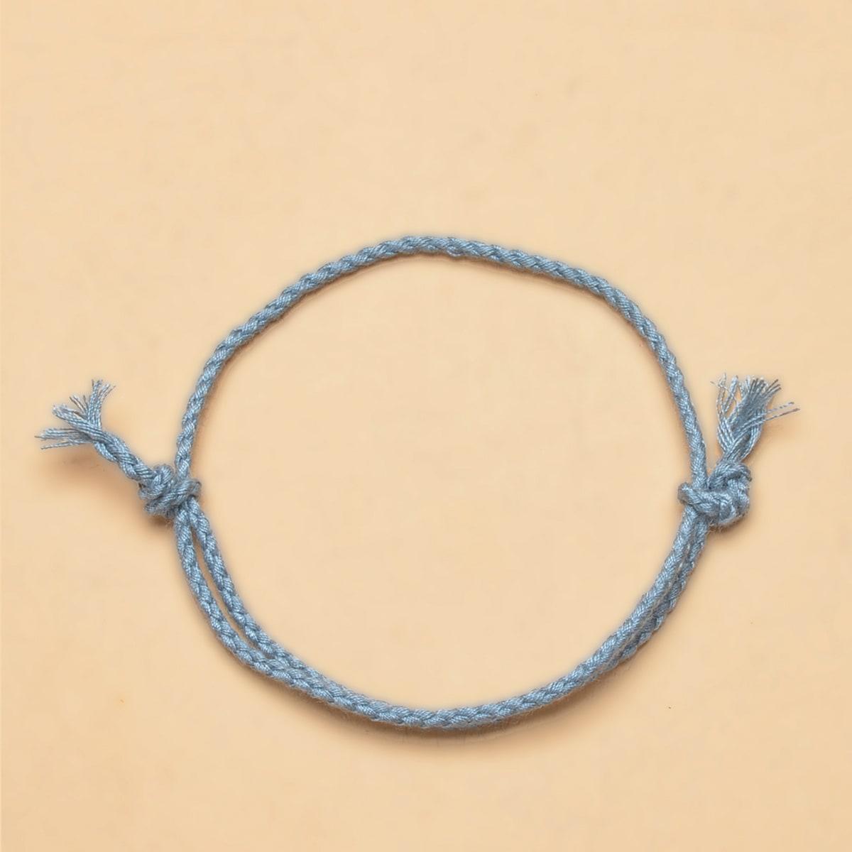 Плетеный струнный браслет