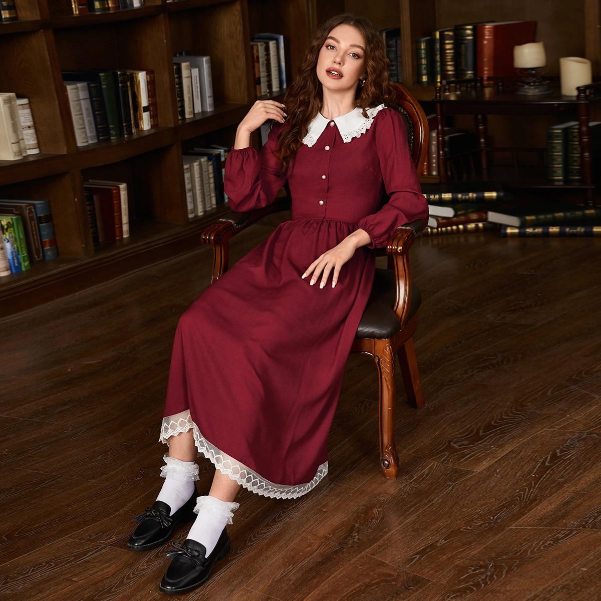 Оригинальное платье с пуговицами и сетчатым краем