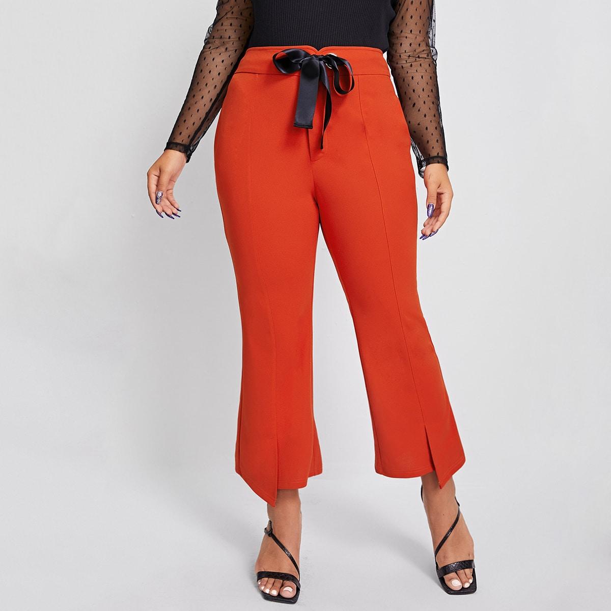 Расклешенные брюки размера плюс с узлом и разрезом