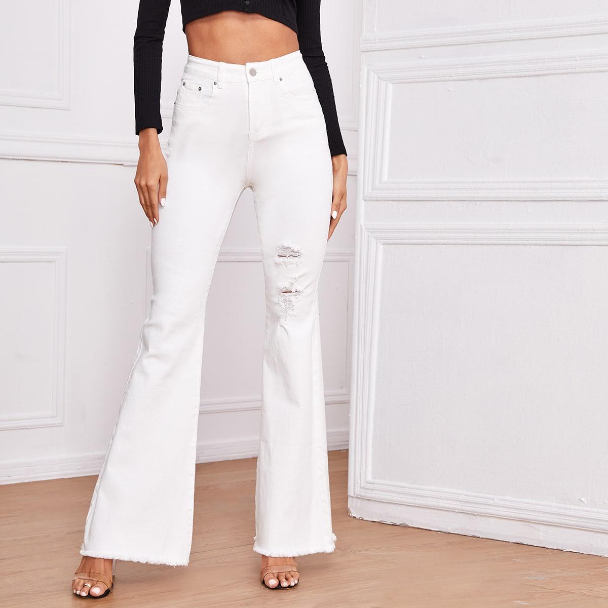 Рваные расклешенные джинсы