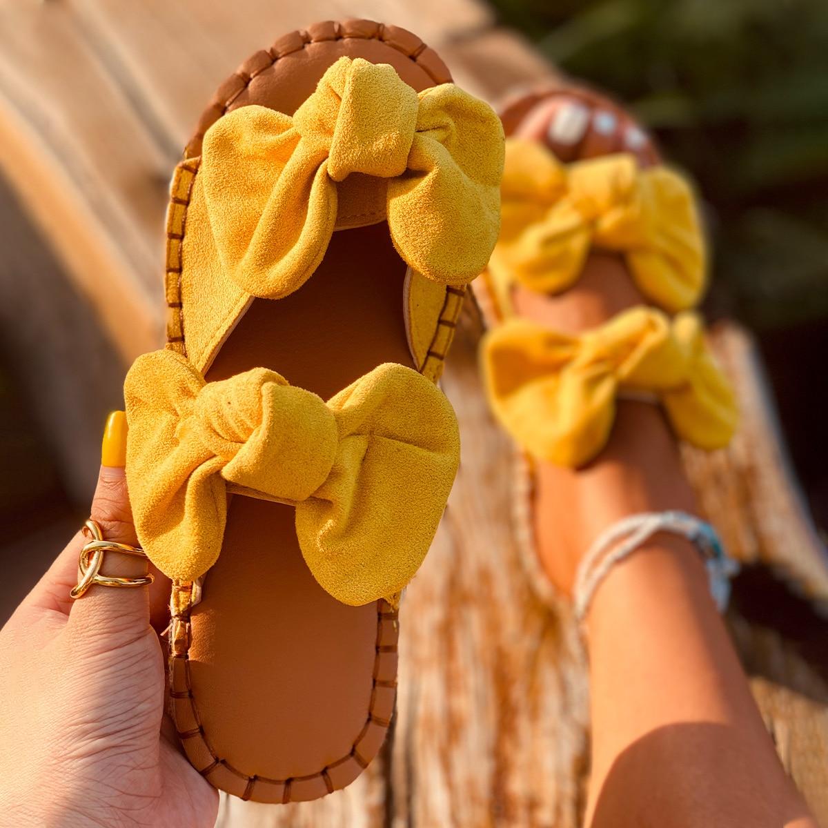 Замшевые сандалии с двойным бантом