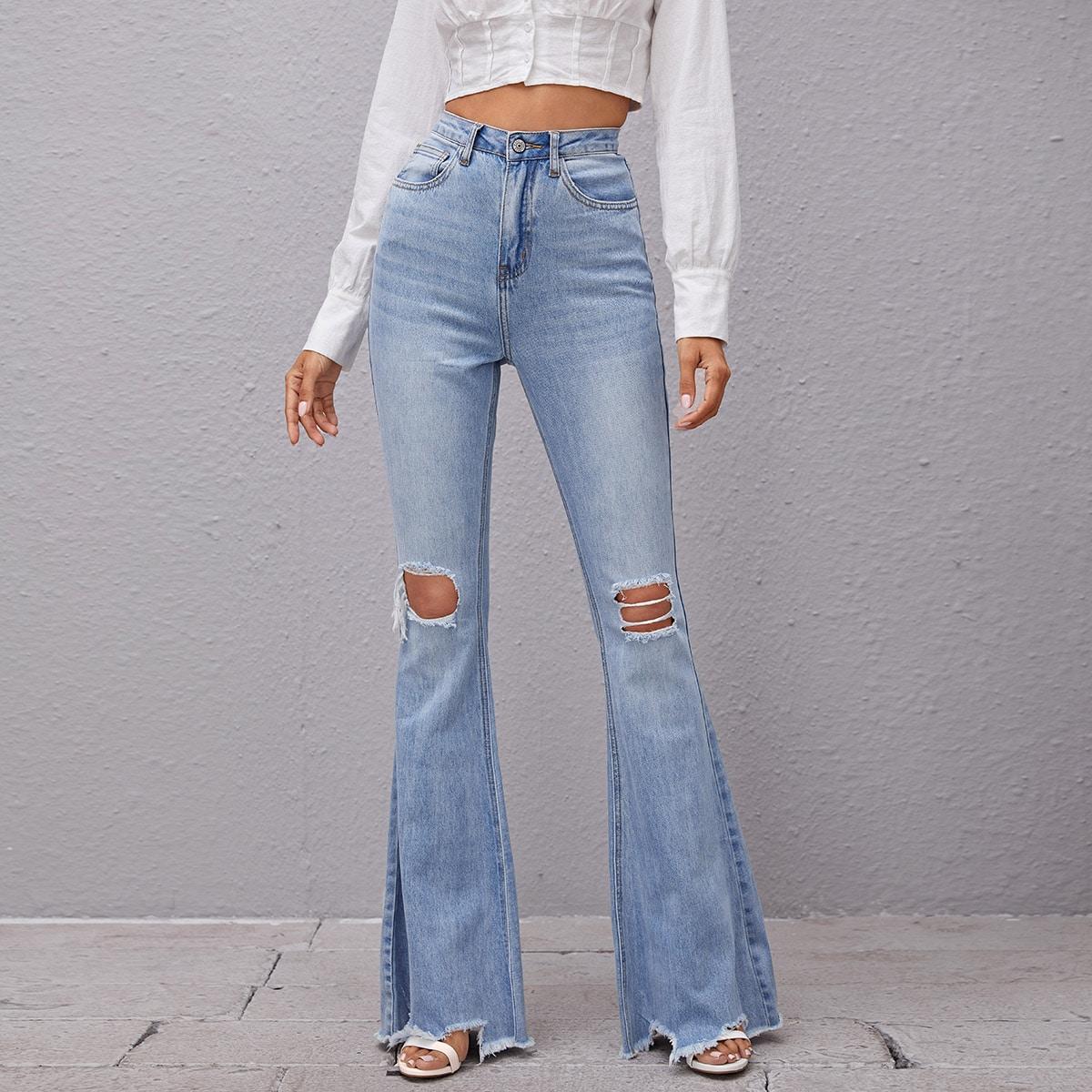 Рваные расклешенные джинсы с высокой талией
