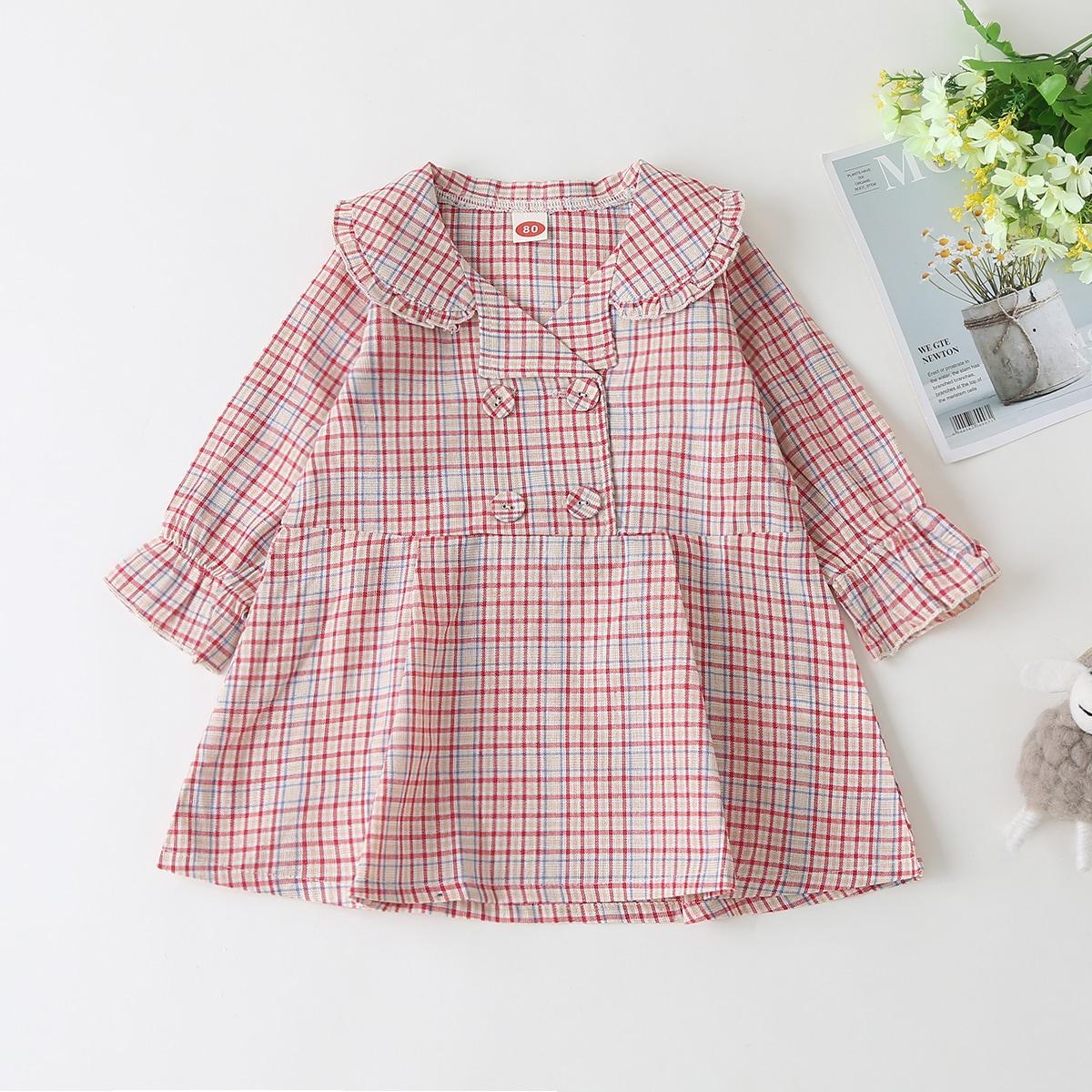 Платье в клетку с оригинальным рукавом для девочек