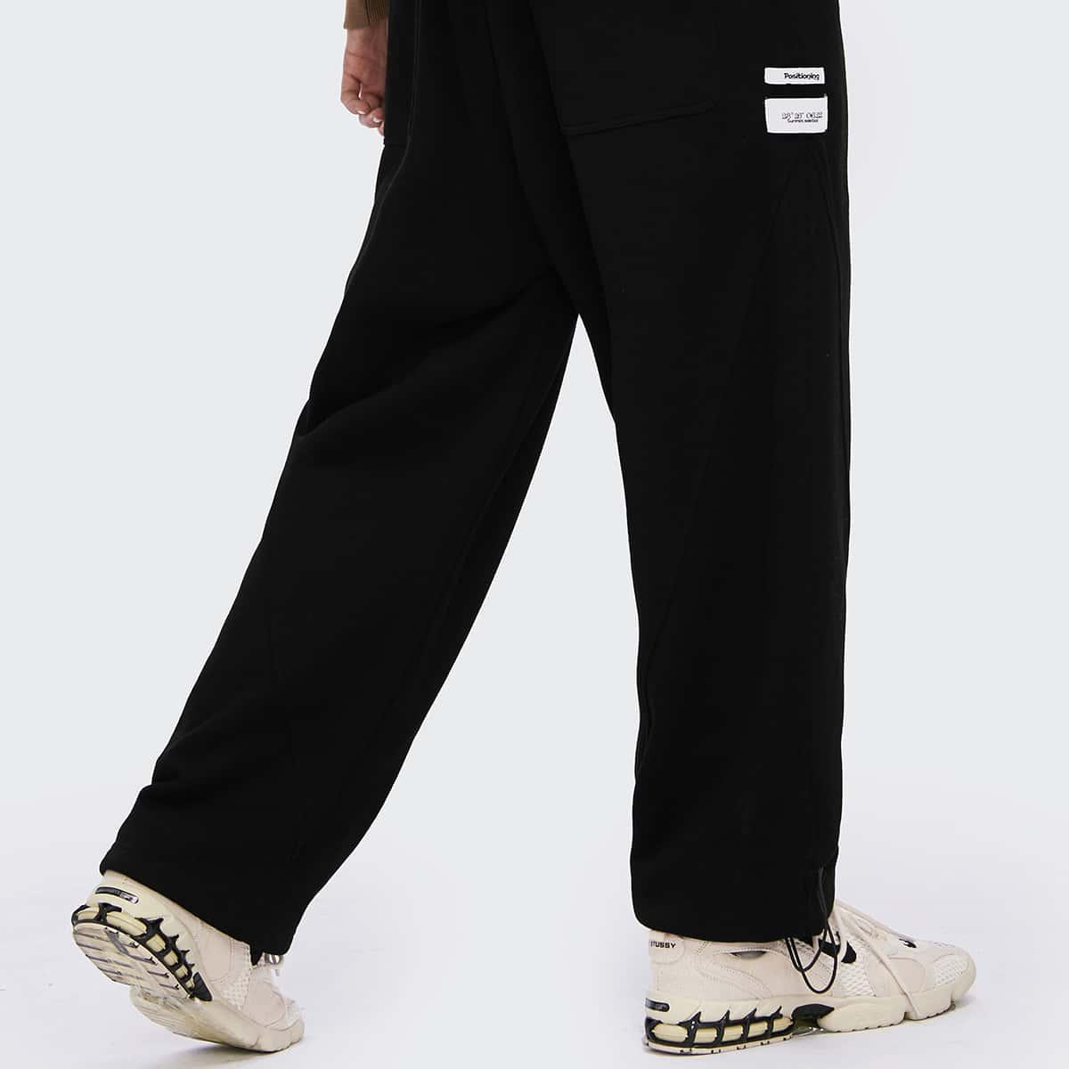 Мужские спортивные брюки с текстовой заплатой и узлом
