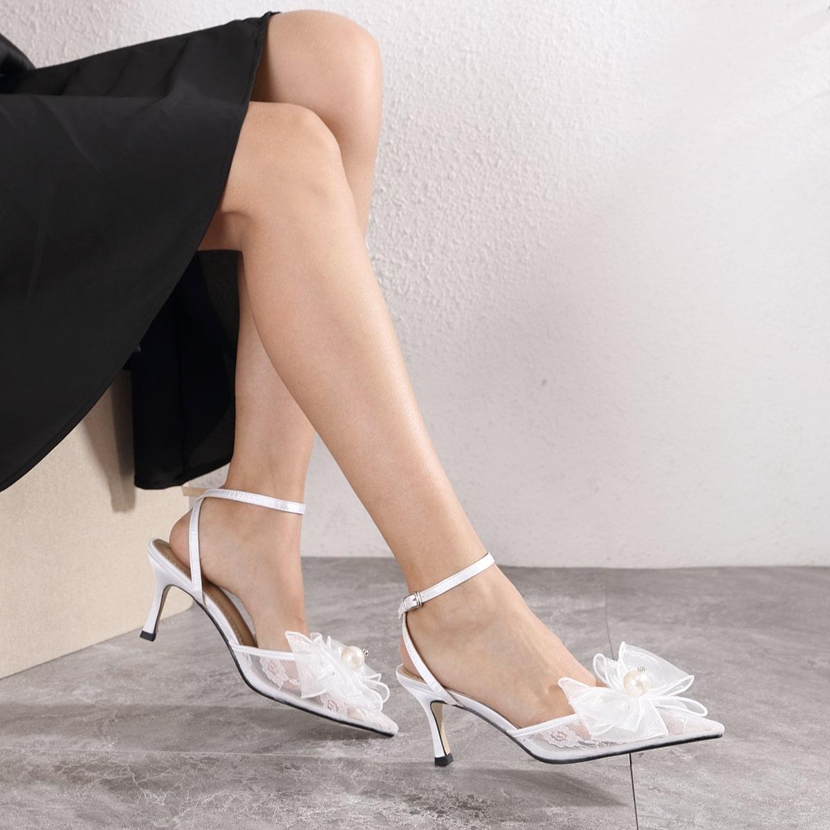 Туфли на высоком каблуке с бантом и искусственными жемчугами
