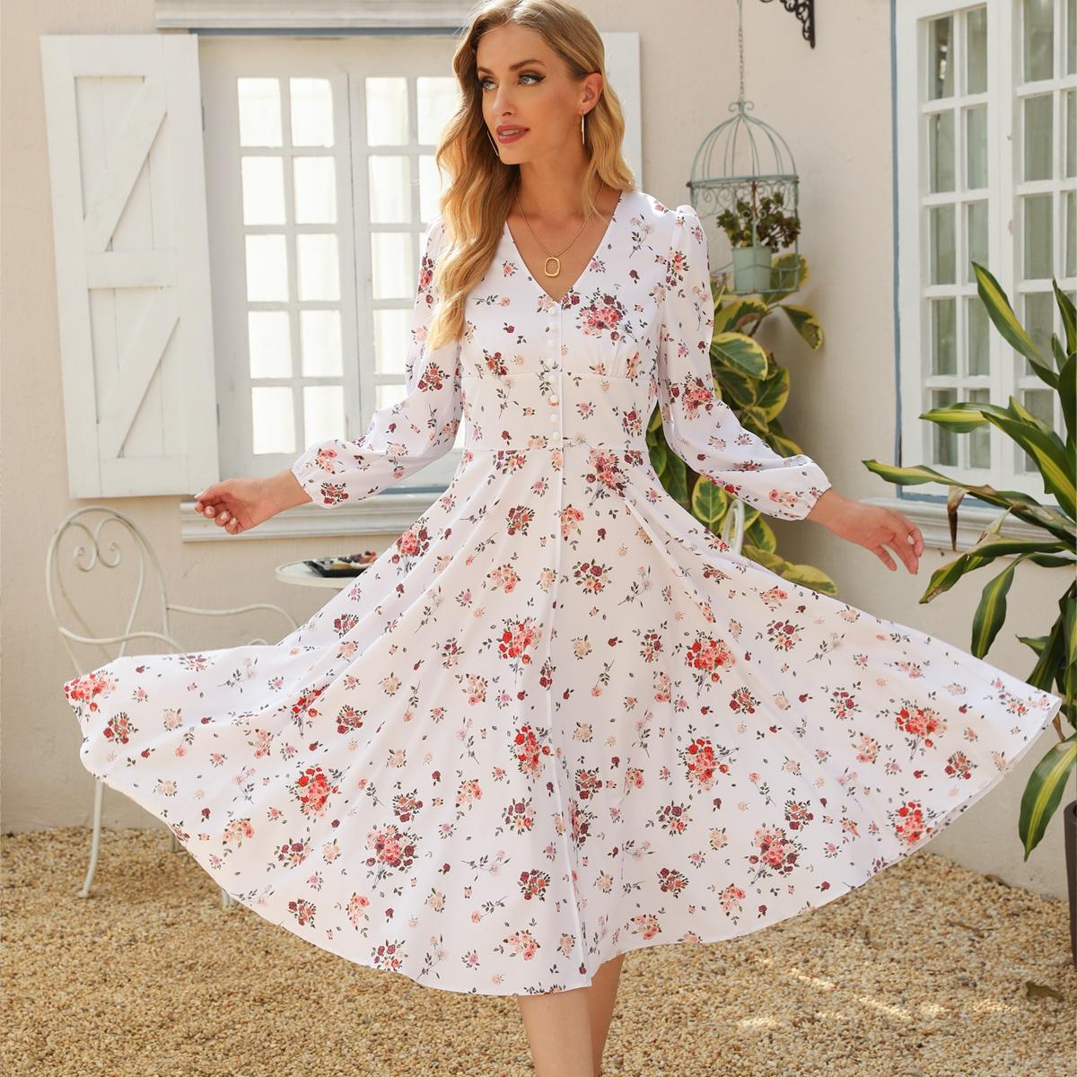 Расклешенное платье в горошек