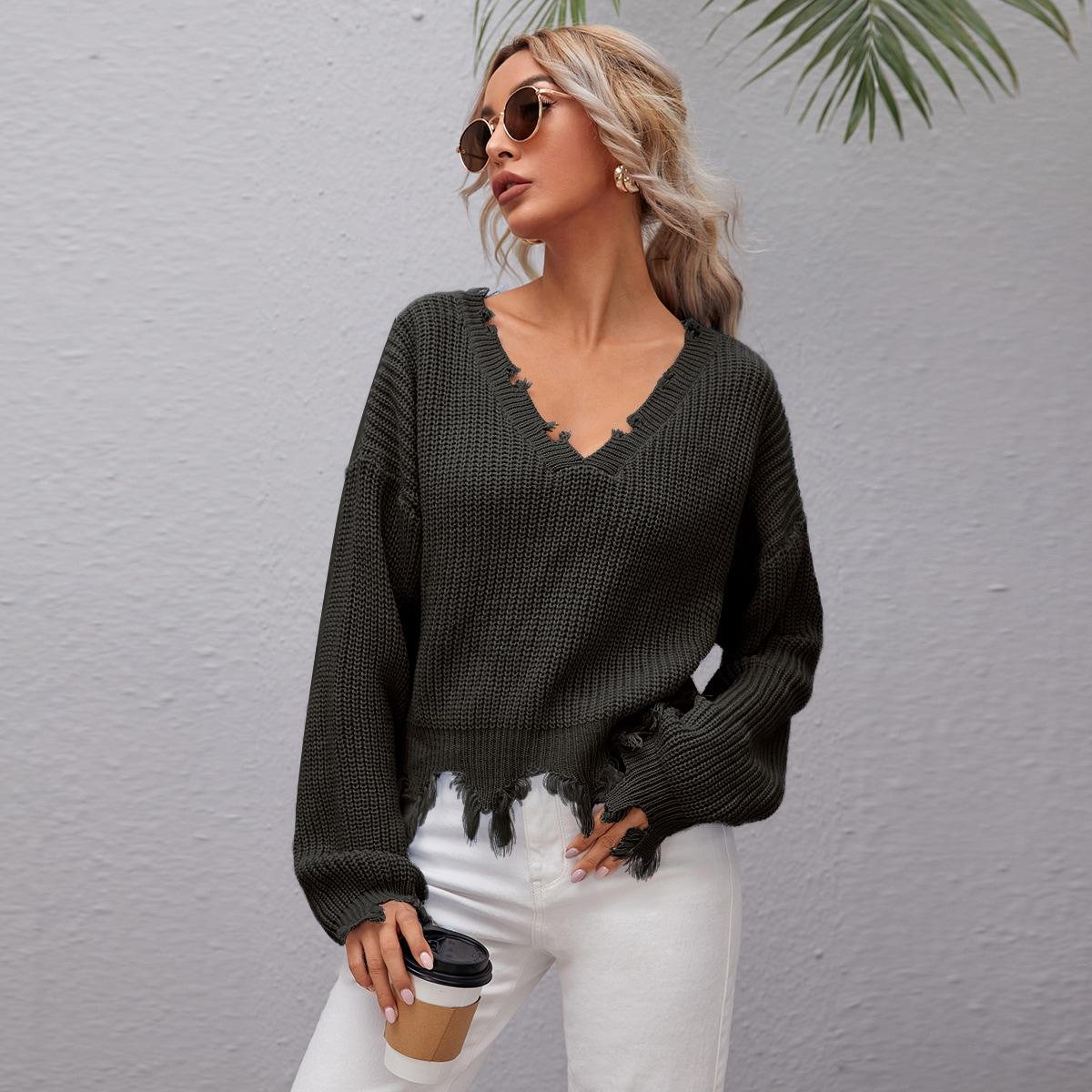 Трикотажный свитер с рваным низом
