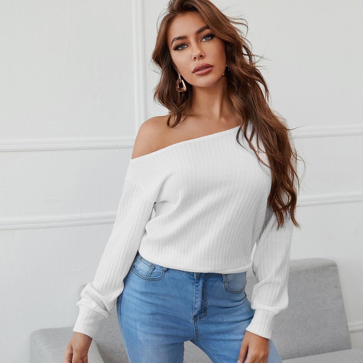 Вязаный пуловер в рубчик