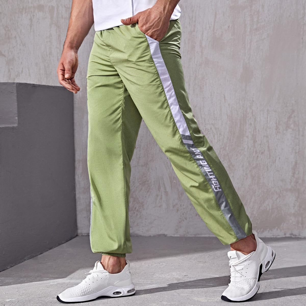 Мужские спортивные брюки с монограммой и боковым швом