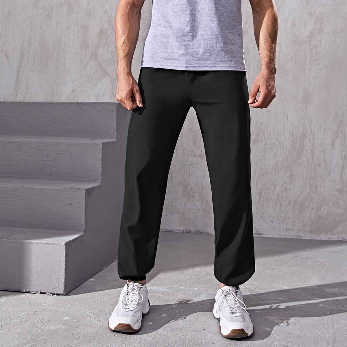 Мужские спортивные брюки с камуфляжным принтом в стиле пэчворк