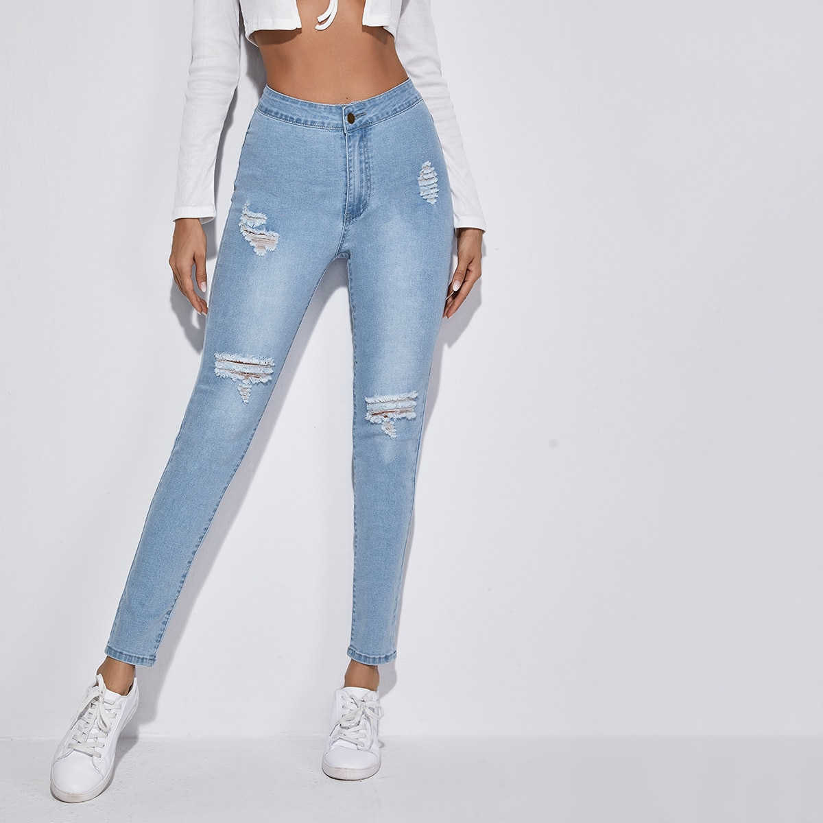 High-Waisted High Stretch Ripped Light Wash Skinny Jeans