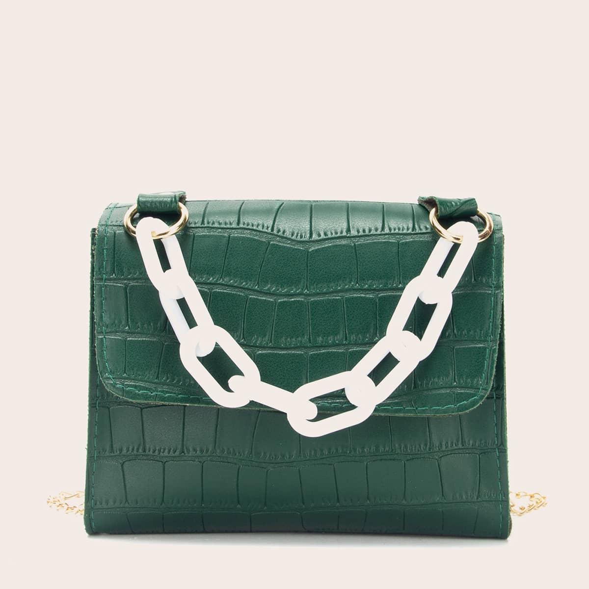 На цепочке крокодил модный сумка