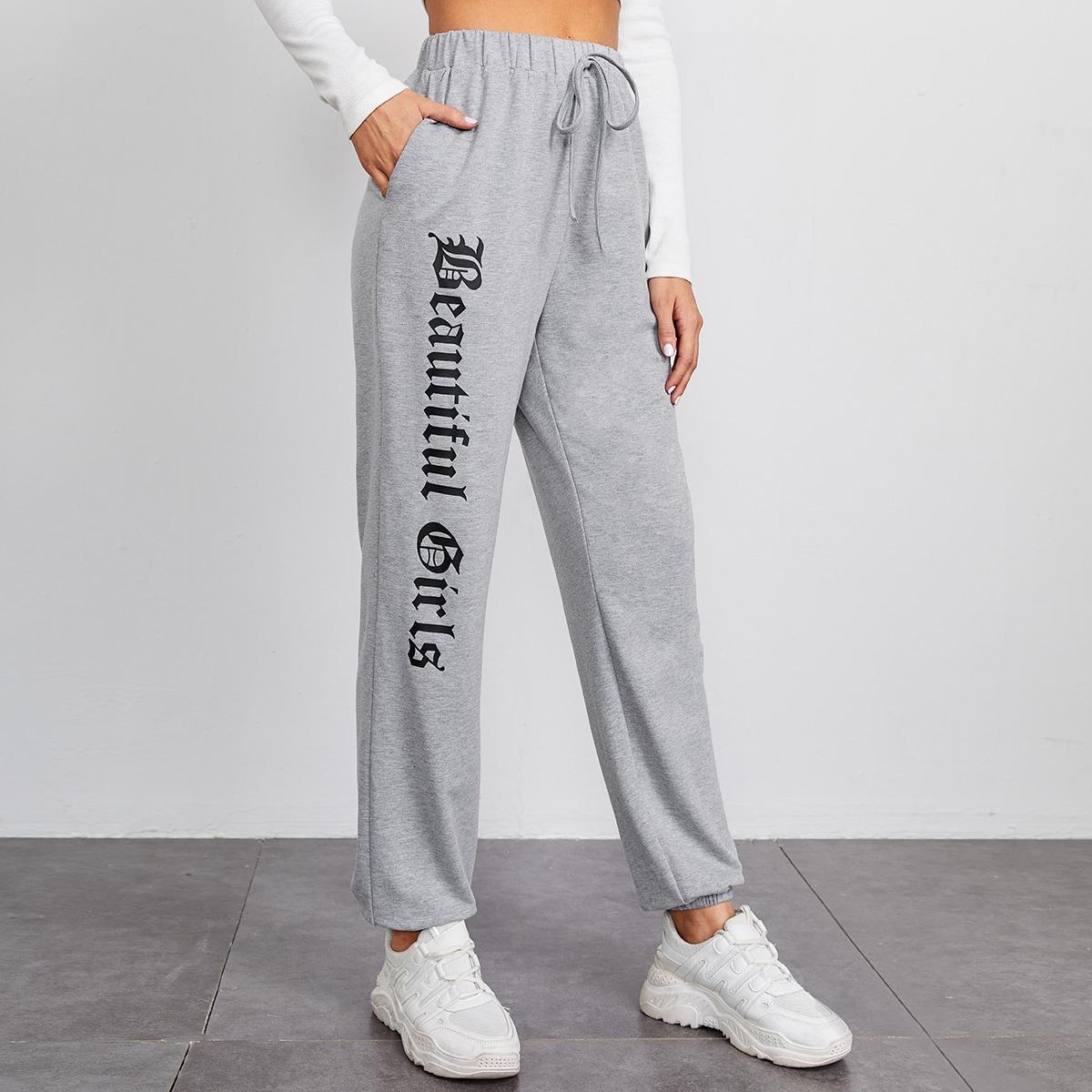 Спортивные брюки с текстовым принтом и узлом