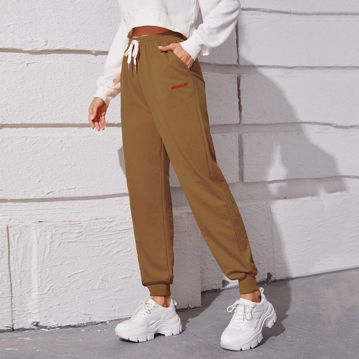Спортивные брюки на кулиске с текстовым принтом