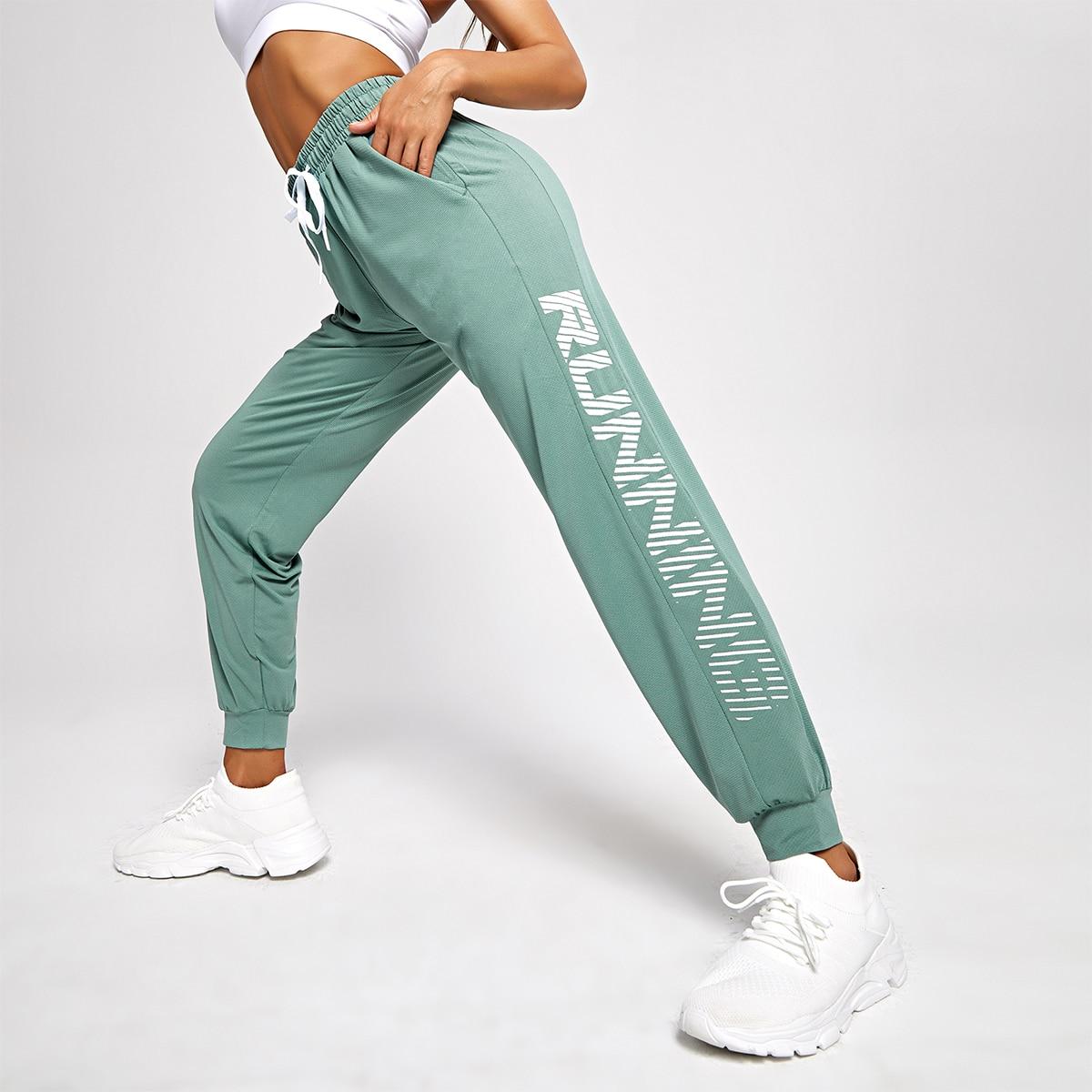 Спортивные брюки с текстовым принтом на кулиске