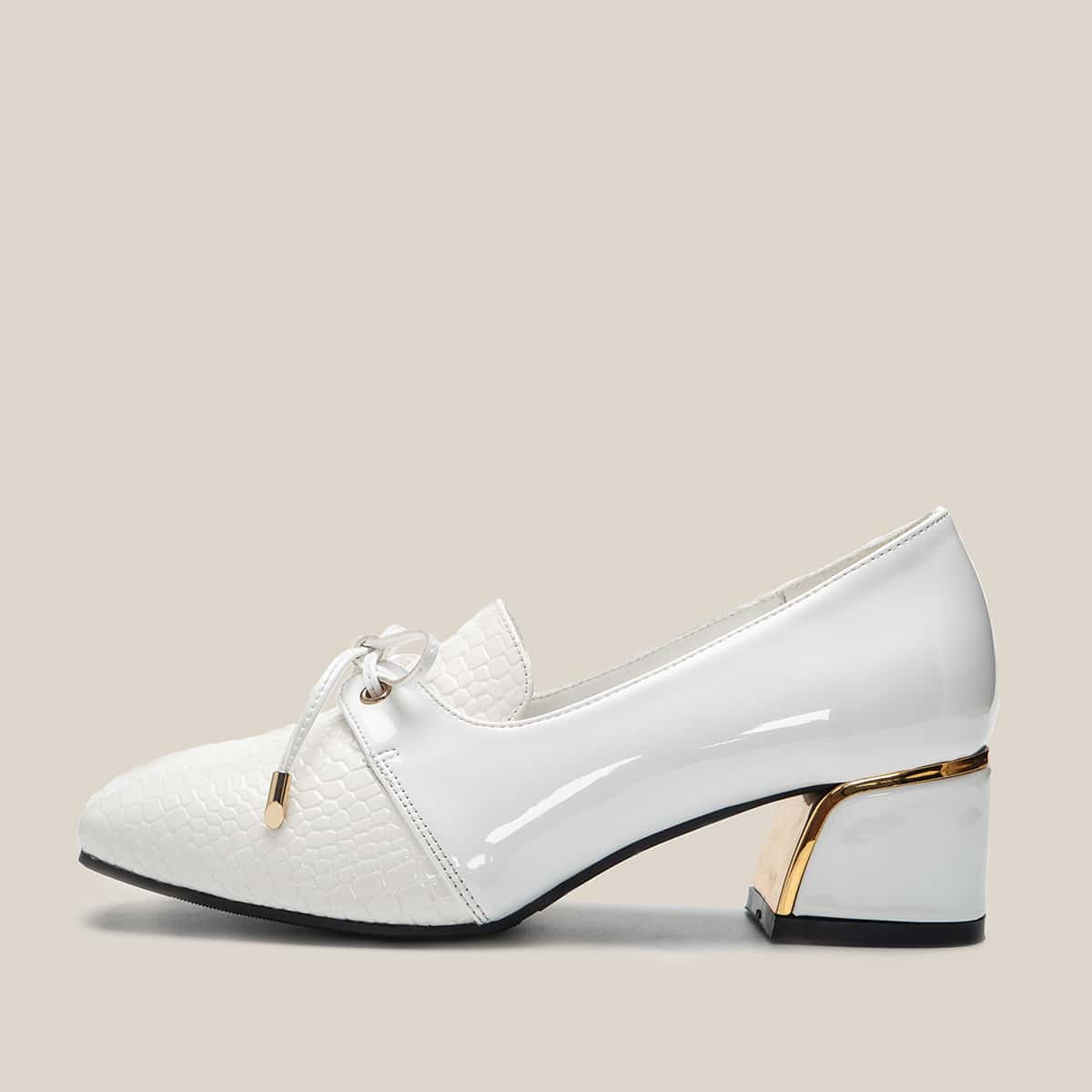 Туфли на массивном каблуке с крокодиловым узором и бантом