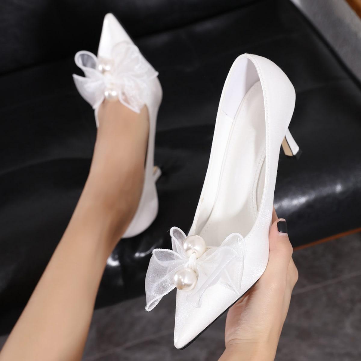 Туфли на среднем каблуке с бантом