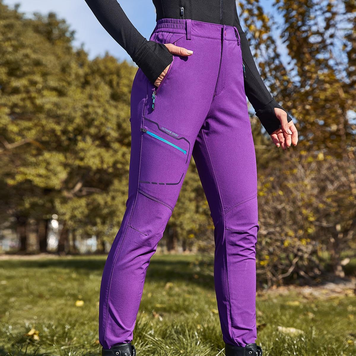 На молнии буква спортивные брюки