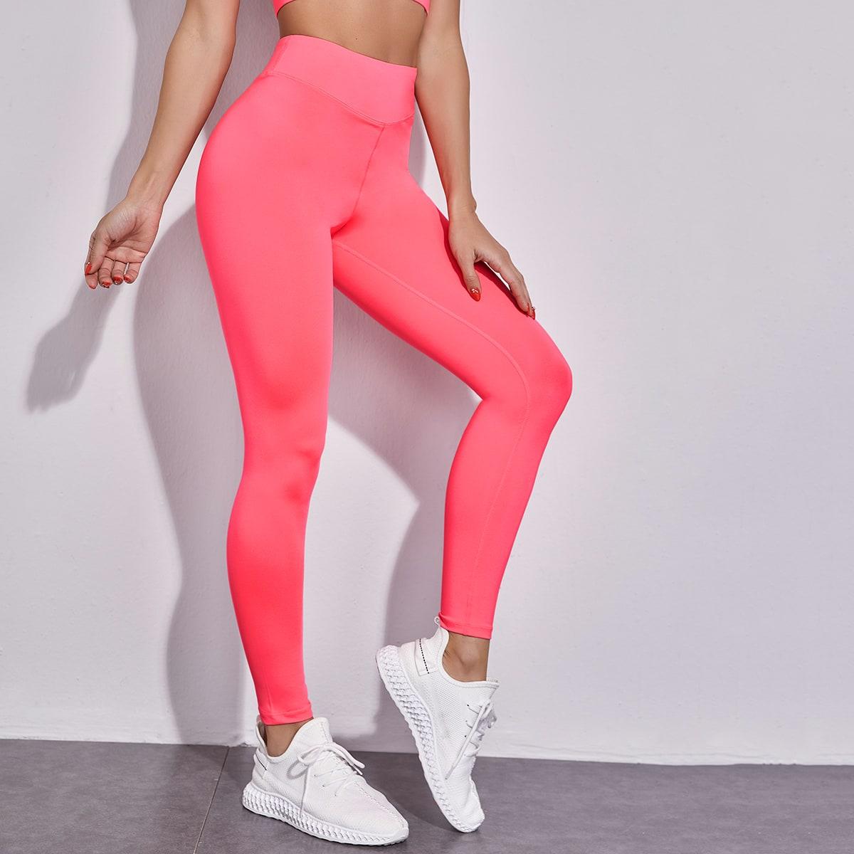 Неоново-розовые спортивные леггинсы