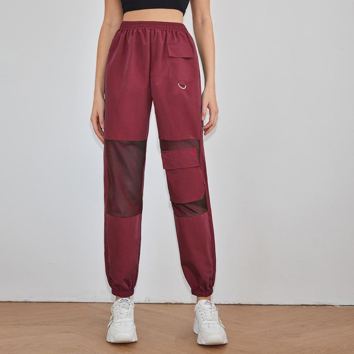 Однотонные брюки с сетчатой вставкой и карманом